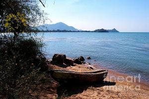 Featured Carved Boat at Lake Malawi 01 Photograph by Dora Hathazi Mendes